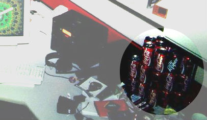 pic of workstation with many soda cans